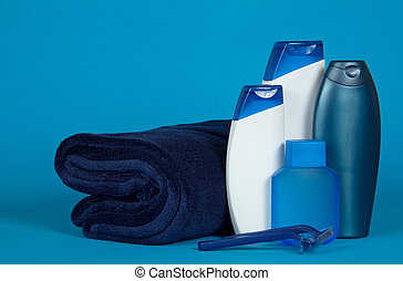 Set of male cosmetics in blue - Towel, shampoo, shower gel...