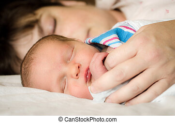 Infant resting next to mother - Newborn infant child resting...