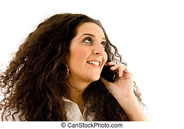latin american woman talking on phone on an isolated...