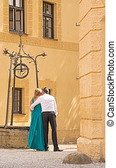 Mid-aged Couple Together Kissing Outdoors Vertical Image