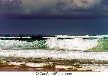 Green ocean waves in stormy wheather. Portugal coast.