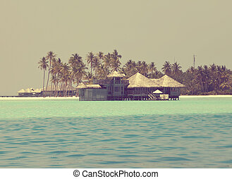 view of the ocean and the house on water,with a retro effect