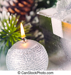 Christmas Holiday Background with burning candle, close up