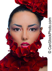 Asian girl with hat of roses isolated on white