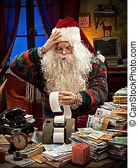 Tax Troubles - Santa Claus accountant going over figures and...