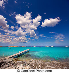 Formentera tropical Mediterranean sea wooden pier in Illetes...