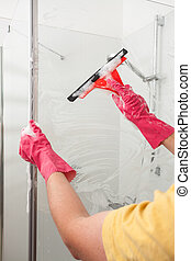 Bathroom tiding up - A man tiding up his bathroom with...