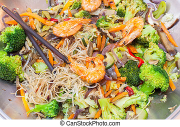 Wok stir fry - Closeup of Chinese food with a wok filled...
