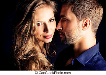attractive force - Portrait of a beautiful young couple in...
