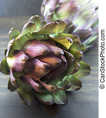 artichoke - Artichokes on wood background
