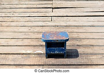 Old small wooden blue fishing chair