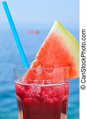 Fresh tropical fruit cocktail with water melon slice on a...