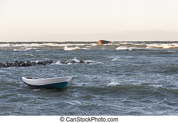Boat in stormy sea - White fishing boat in stormy wavy sea