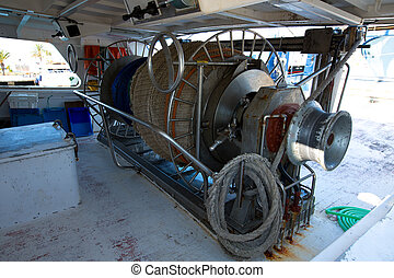 Fishing trawler boat engine motor huge winche on deck