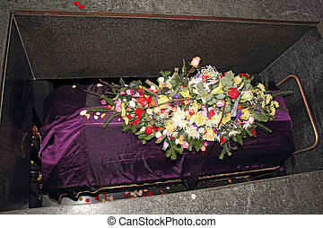 Coffin - A coffin in a morgue with a flower arrangement
