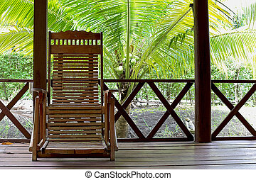 wooden chairs on a patio in the garden - wooden chairs on a...