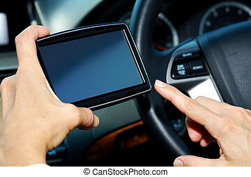 Car driver hands with GPS Road destination