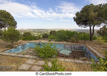 Modern swimming pool full of debris and abandoned