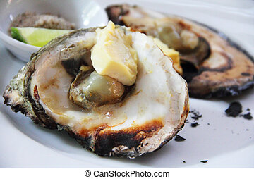 Oyster - Cooked Oysters with cheese on plate close up