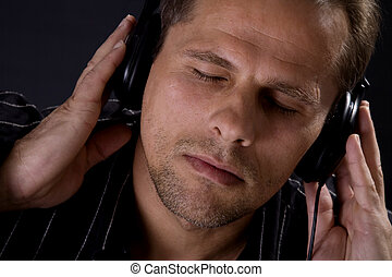 Man wearing headphones - Caucasian man listening to...