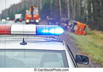 police car with a flasher at lorry crash - police car with a...