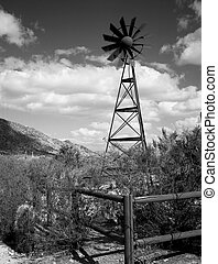 Windmill in the central Arizona mountains black and white