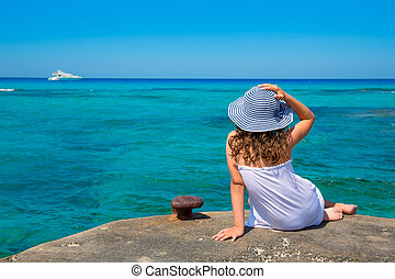 Girl looking at beach in Formentera turquoise Mediterranean