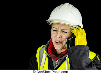female builder shouting on phone - female builder unhappy on...
