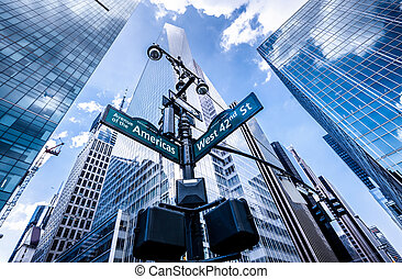 Direction signs in New York at intersection