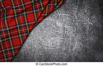 tartan textile on stone background