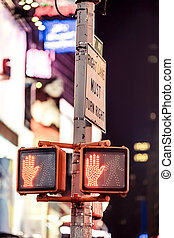 Dont walk New York traffic sign with illuminated and blurred...