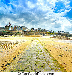 Saint Malo beach and stone pathway, low tide. Brittany,...