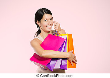 Happy woman shopper with colorful bags