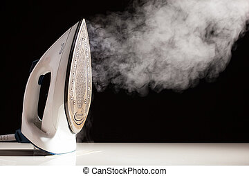 steam generator iron on black background