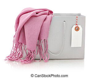 Pink scarf in shopping bag with tag isolated on a white...