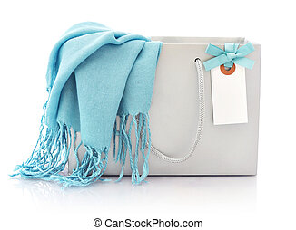 Blue scarf in shopping bag with tag isolated on a white...