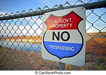 No Trespassing US Government Property Warning Sign on Fence...
