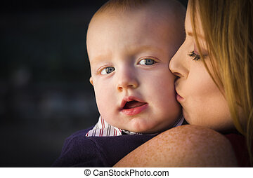 Adorable Red Head Infant Boy is Kissed By His Mother...