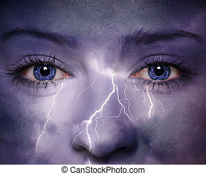 Nature background - Woman face with thunderstorm painted on...