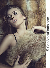 sensual glamour woman on fur background - sensual young...