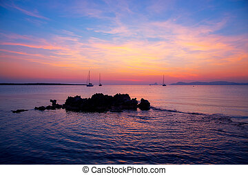 Ibiza sunset view from formentera Island with sailboat in...