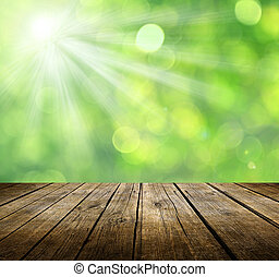 Empty table - Empty wooden deck table with green background....