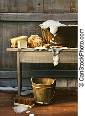 Old wash tub with soap and scrub brushes