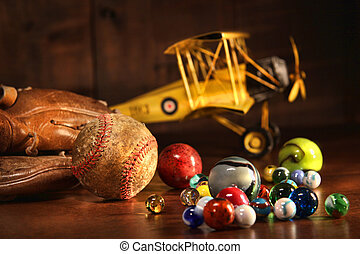 Old baseball and glove with antique toys on wood floor