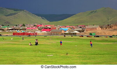 Mongolian Kids are playing at steppe of ulaanbaatar suburbs