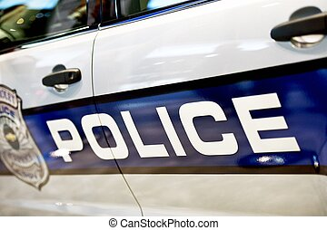 Police Car Closeup on Door - Police Cruiser Wraps. Traffic...