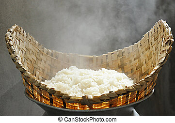Sticky rice - Hot sticky rice in traditional wooden steamer...