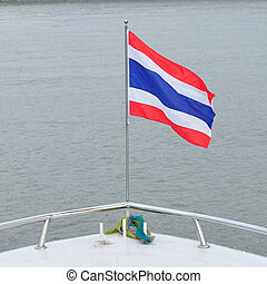 Thailand flag in front of big boat