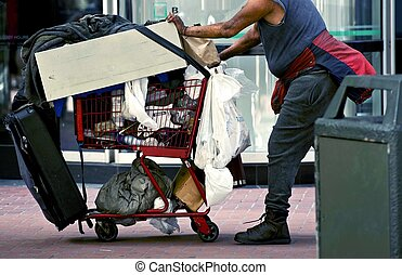 Homeless with Shopping Cart in San Francisco, California,...