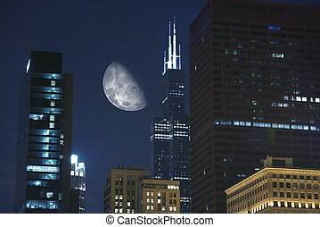Night Hours in Chicago. Large Moon Between Skyscrapers....